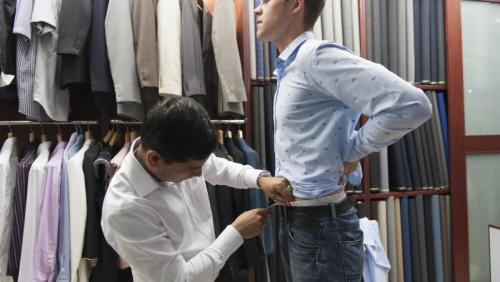 [7] Our tailor proceeds to measure the waist for the tailoring of the pants